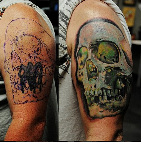 Skull cover up tattoo by Trent Valleau