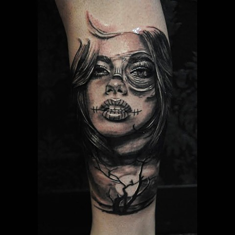 Skull girl tattoo by Trent Valleau