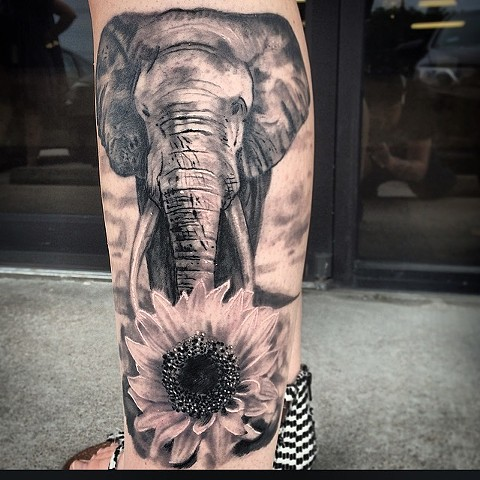 Realistic elephant and sunflower Tattoo by Trent Valleau