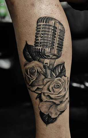 Microphone and roses tattoo by Trent Valleau
