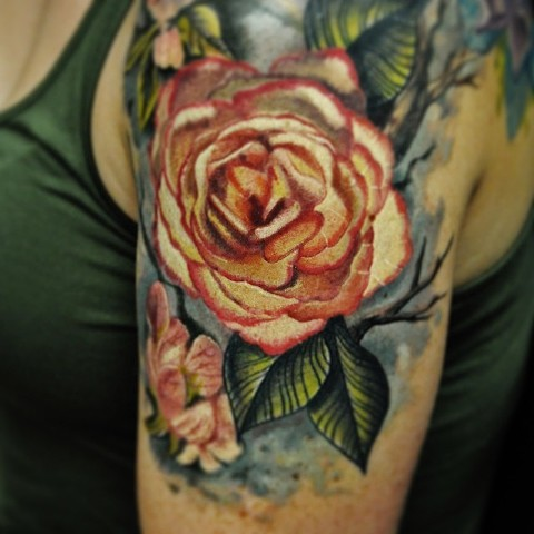 Realistic flowers tattoo by Trent Valleau