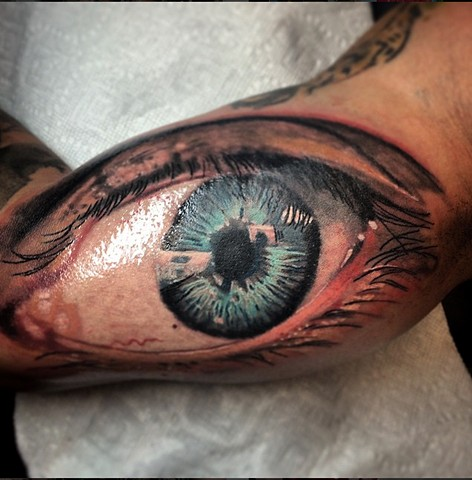 Realistic eye tattoo by Trent Valleau