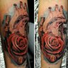 Heart/rose morph tattoo by Trent Valleau
