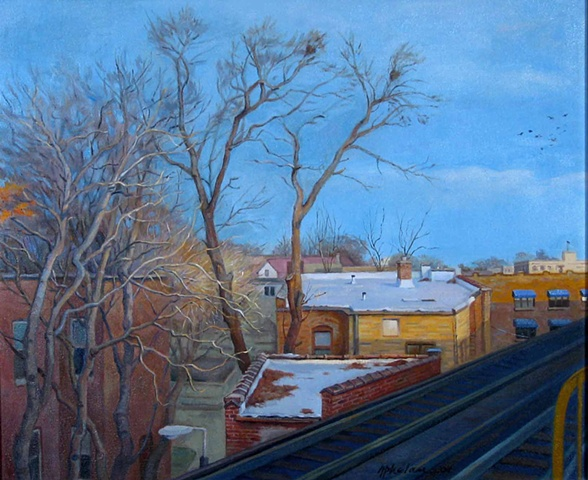 view from elevated tracks on winter morning with roofs and trees