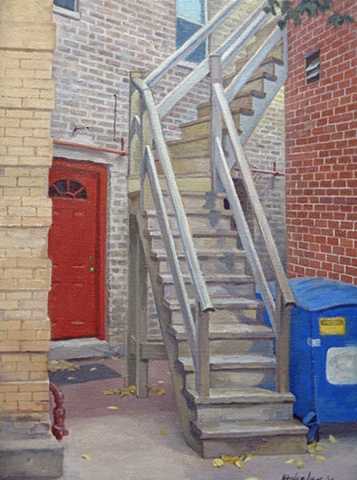 welcoming red door amidst bricks and wooden stairway leading around a corner, with autumn leaves and garbage bin by Mary Phelan