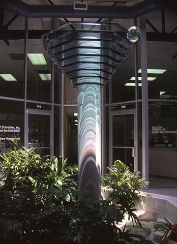 Sculpture, concrete and glass.