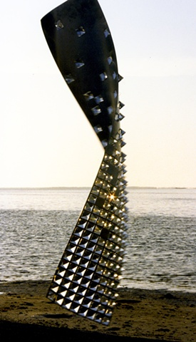 Stainless steel and lead crystal sculpture.