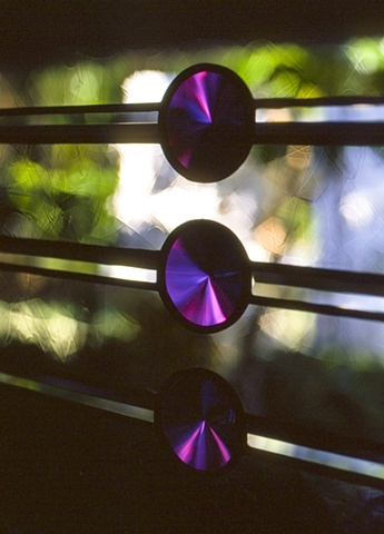 Beveled dichroic glass.