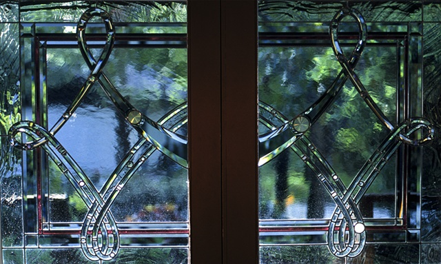 Beveled and stained glass front doors.