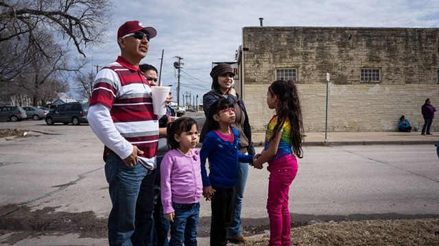 "Restoring vandalized ""Immigration is Beautiful"" mural in Wichita KS"