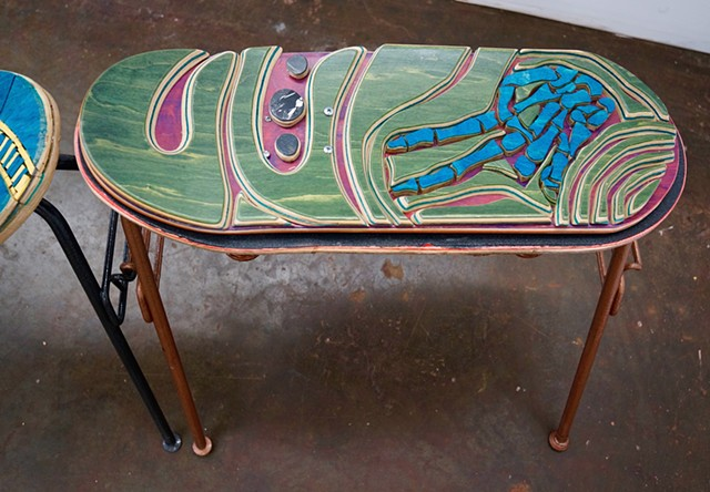 Unique, colorful, functional sculptures created from recycled skateboards and chairs.