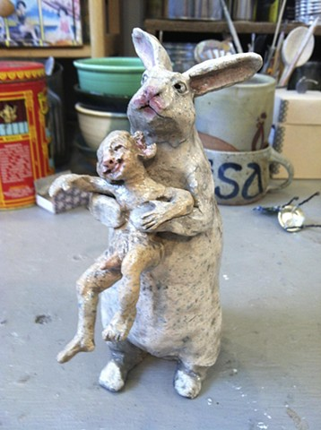 bunny eating boy ceramic sculpture by lisa schumaier