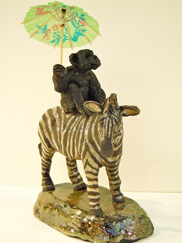 raku ceramic monkey and zebra