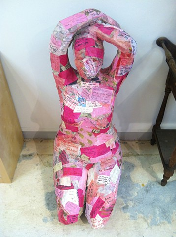 """woman of hope and healing"" papier mache and notes and thoughts collected from visitors to the torpedo factory"