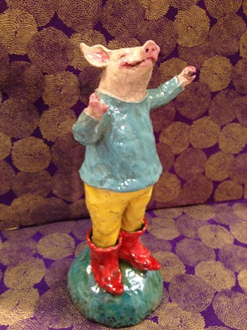 cheerful raku ceramic pig wearing boots - lisa schumaier