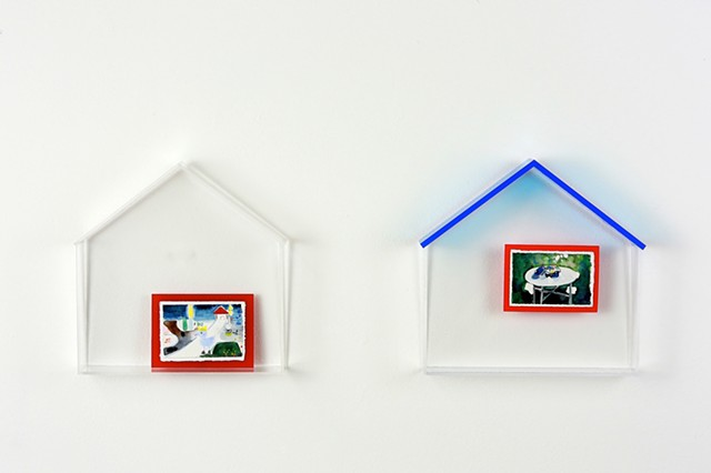 a picture with red frame and blue rooftop house 1
