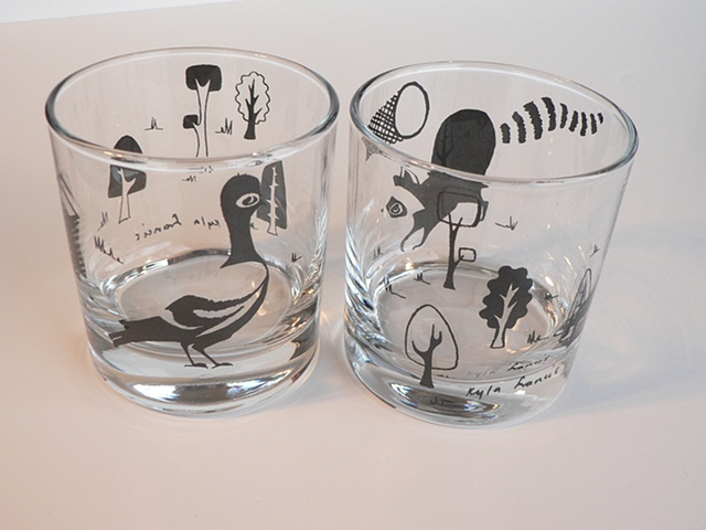 glass tumbler screen printed by hand with urban images; pigeon, racoon and garbage cans
