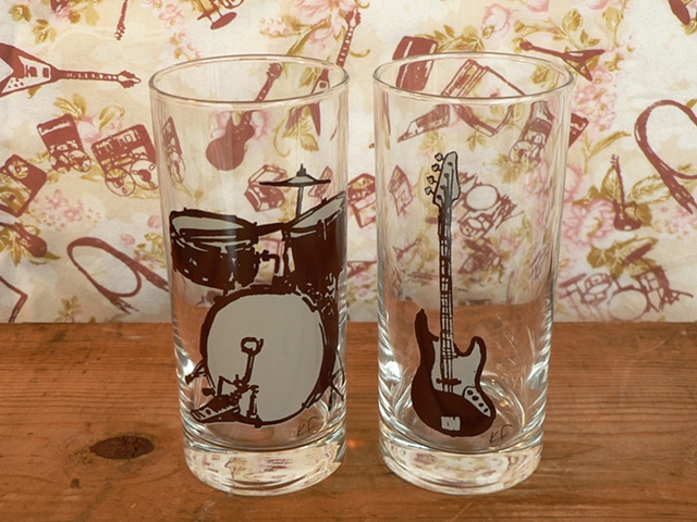 Hi ball glass screen printed with the instruments of a pared down band; bass guitar and drums