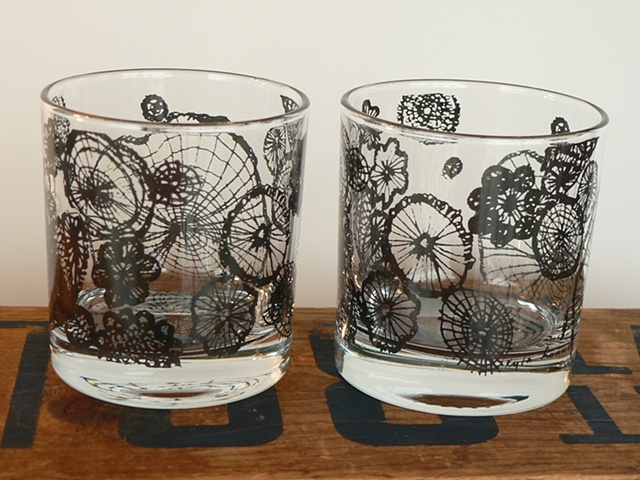 glass tumbler screen printed by hand with image of handmade lace in black
