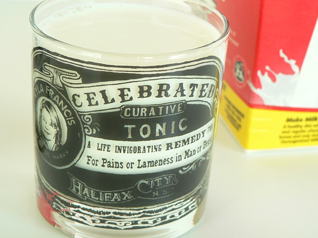 glass tumbler screen printed by hand with image inspired by patent medicine, curative tonics and herbal remedies