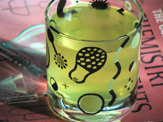 Tumbler glass screen printed with doodles inspired by chemistry diagrams