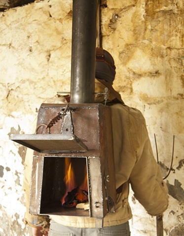 backpack wood stove functional art sculpture