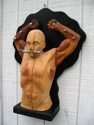 wood sculpture figure torso bolts wrench male