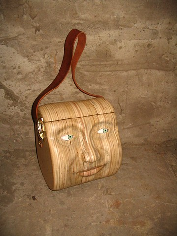 purse sculpture head carving face wood leather
