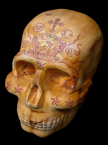 skull carving sculpture by Tim Pewe illustrated by Mark Arminski