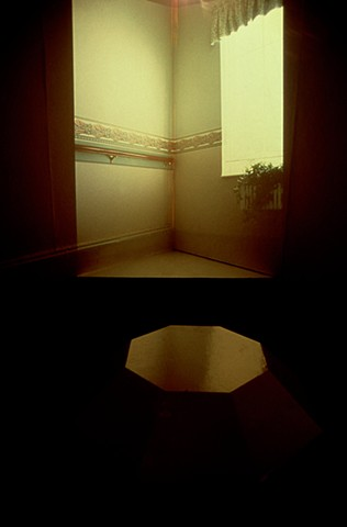 Installation with 4 slide projectors, projecting images of corners back into the corners of a square room.