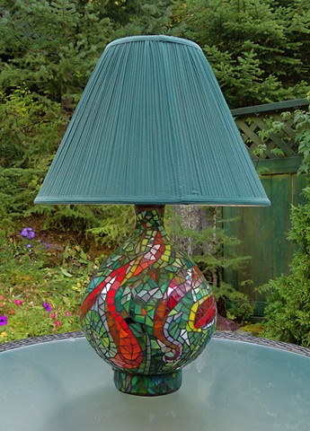 A recycled lamp base covered with an abstract design in stained glass