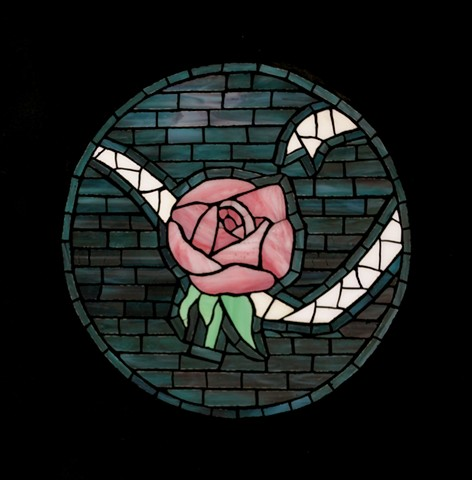 A mosaic of a single pink rose