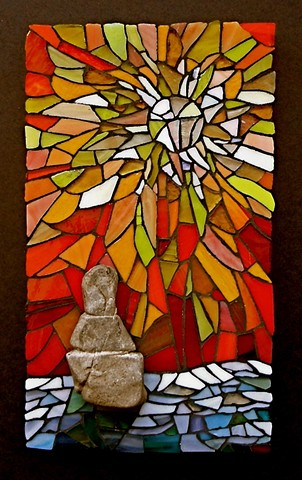 stained glass and rock mosaic inukshuk