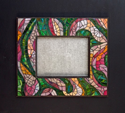 An abstract mirror frame with the colours I love in a garden in summer