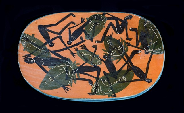 orange platter with figures