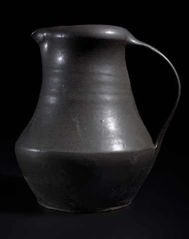 Black hand thrown pitcher