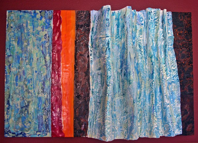 Colorful and textured  three dimensional encaustic waterfall.