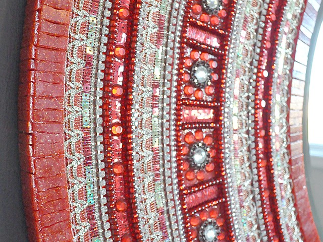 The Red Saree Mirror Detail