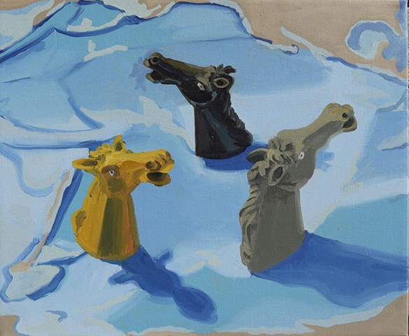 still life painting, map of the pacific with horse finder puppets
