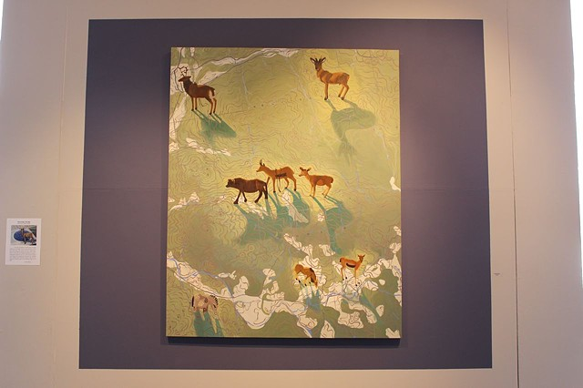 Oil painting of deer and Vermont topographical map