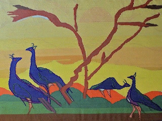 """Peacocks in the field"""