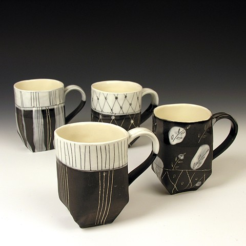 Hand built porcelain cups with undergalze and scratched through decoration