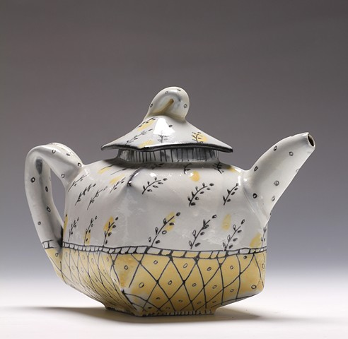 "Hand built teapot with scratched ""wallpaper"" decoration"