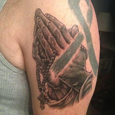 Praying hands tattoo by Eric Hendrickson (pre-existing black ribbon tattoo not by Eric)