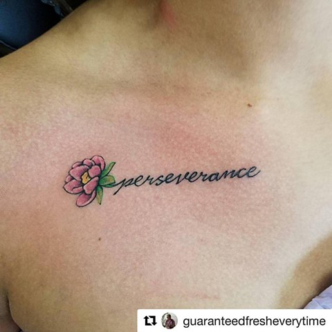 Script and Flower Perseverance Tattoo