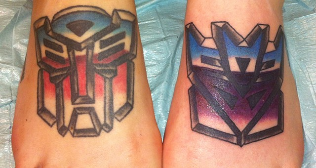 Transformers Decepticon and Autobot Tattoo