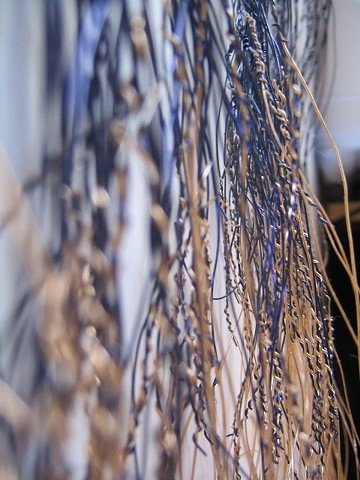 Wires twisted and woven together to create a wall art piece