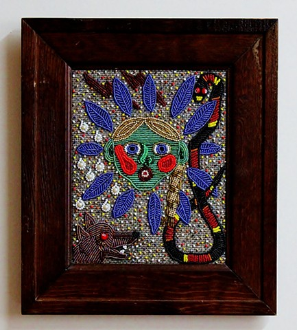 Beaded portrait using seed beads stitched on cloth of Jazz Bailey by Ann Laase Bailey