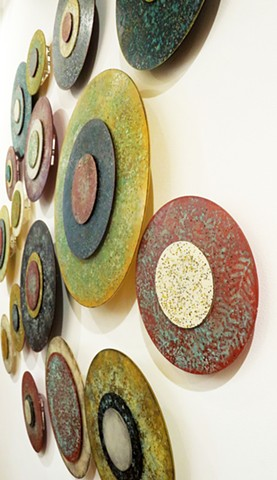 detail abstract circular paintings on acrylic panels dimensional wall sculpture