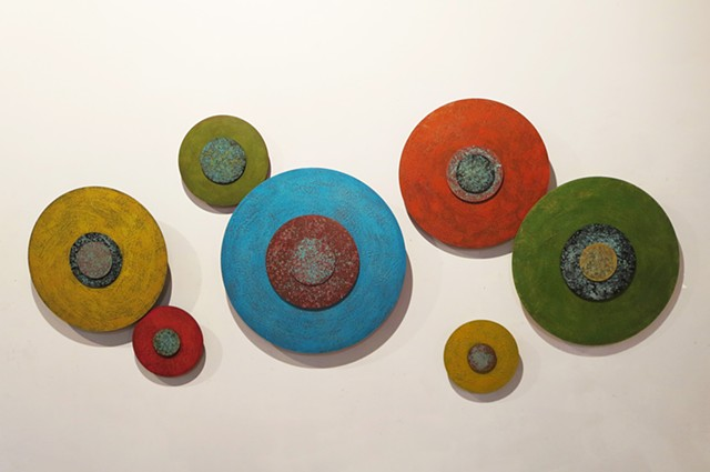 Abstract encaustic wall sculpture on acrylic circles in bright colors